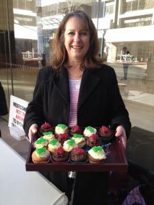 Kathy Calman at Westconnex Action Group early morning stall outside Westconnex headquarters with her frog cakes