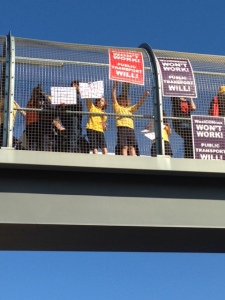 Students from Haberfield Primary School protesting on the pedestrian bridge after school