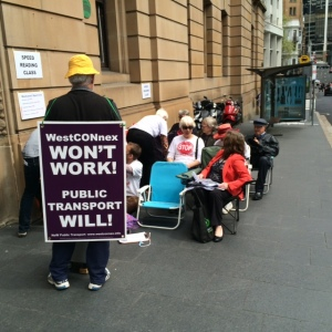 NoWestconnex Campaigners conduct a 'speed reading' session to highlight insufficient EIS consultation time